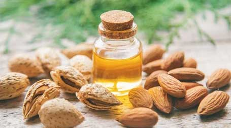 Almond Oil Almond oil is rich in vitamins D, E and natural minerals that soothe skin, protect from and reverse UV damage, and restore the natural moisture barrier. It also helps reduce stretch marks, hydrates skin and reduces irritation.
